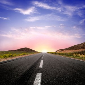 Image of a road heading off into a beautiful sunset